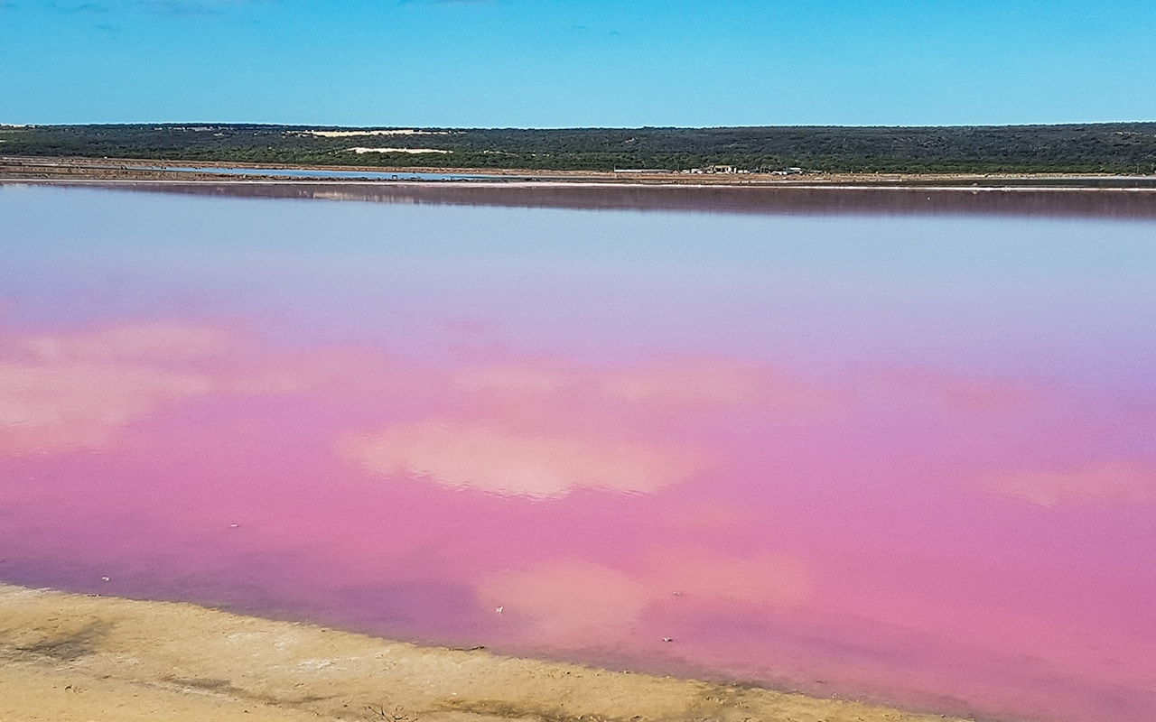 The clouds are reflected in pink at Hutt Lagoon