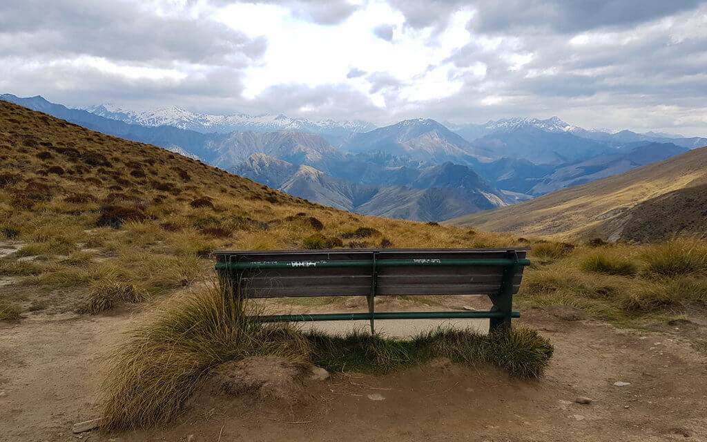 There is a lonely park bench at Ben Lomond Saddle to enjoy the view
