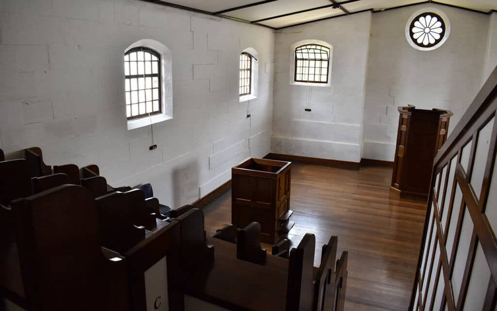 The chapel within the Separate Prison has individual booths for convicts to attend mass